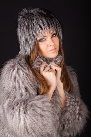 portrait of a beautiful smiling woman in furs photo