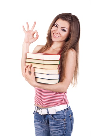 Portrait of a young woman with books isolated photo