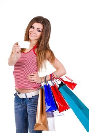 Young woman holding shopping bags and card photo