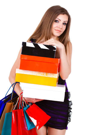 Beautiful young woman with shopping bags and gifts photo