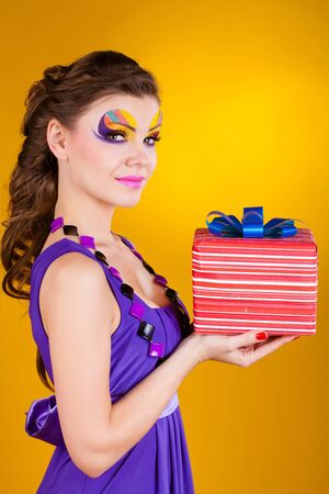 make a gift: beautiful woman with make up in dress with a gift  Stock Photo