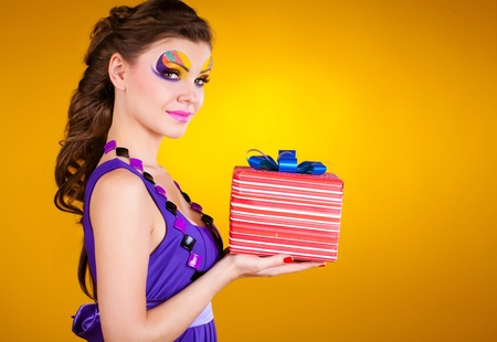 beautiful woman with make up in dress with a gift  photo