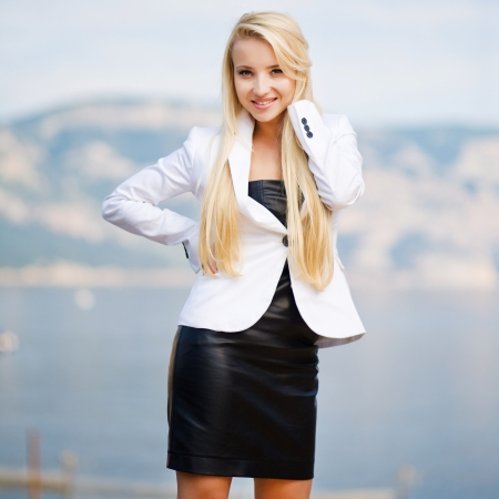 attractive women: portrait of a beautiful business woman outdoors