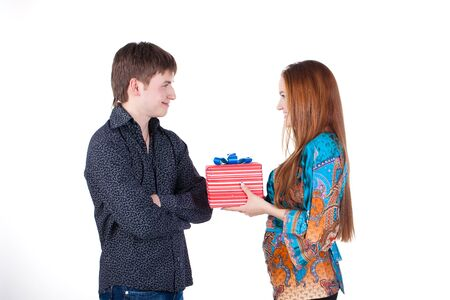 young couple with a gift isolated photo