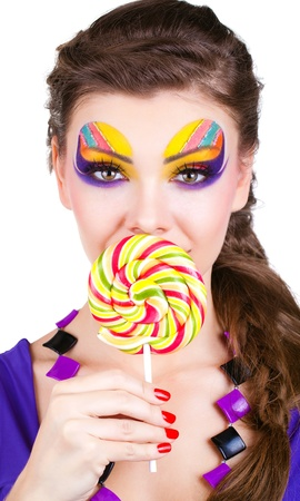 portrait of a glamourous beautiful woman holding lollipop Stock Photo - 12533575