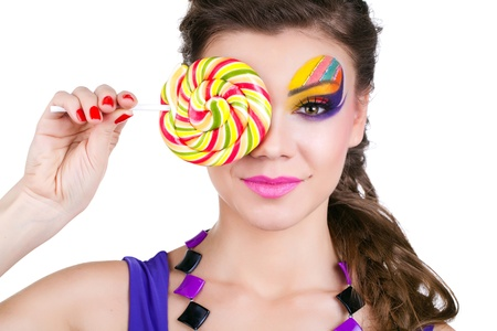 portrait of a glamourous beautiful woman holding lollipop Stock Photo - 12531764
