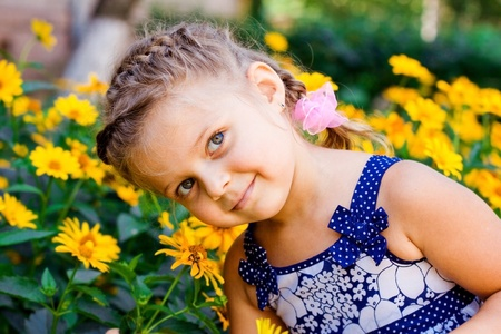 eyeing: Beautiful Happy Little Girl outdoor