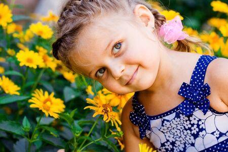 Beautiful Happy Little Girl outdoor photo