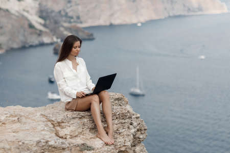 Young happy business woman with laptop outdoor