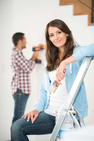 handywoman: Young woman ready to reform house