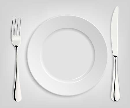 empty plate: Empty plate with knife and fork isolated on white.