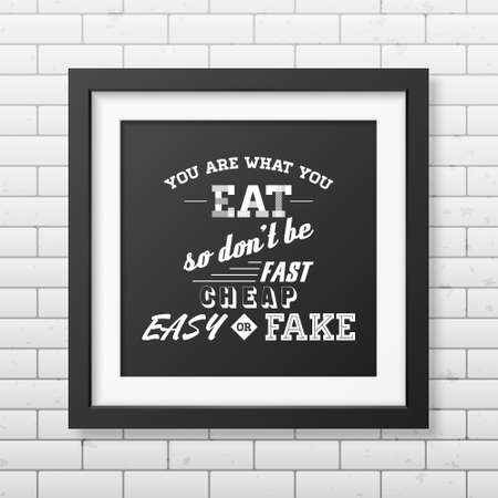 what to eat: You are what you eat so do not be fast easy cheap or fake - Quote typographical Background in realistic square black frame on the brick wall background.