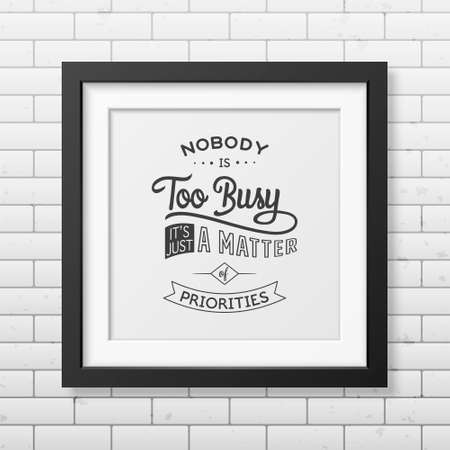priorities: Nobody is too busy, it is just a matter of priorities - Quote typographical background in the realistic square black frame on the brick wall background. Vintage typography background, mockup for design, vintage typography design, vintage typography art, v