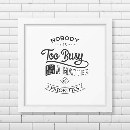 priorities: Nobody is too busy, it is just a matter of priorities - Quote typographical background in the realistic square white frame on the brick wall background. Vintage typography background, mockup for design, vintage typography design, vintage typography art, v