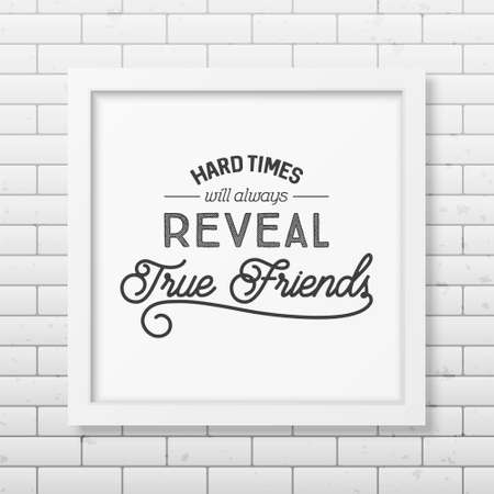 reveal: Hard times will always reveal true friends - Typographical Poster in the realistic square white frame on the brick wall background.