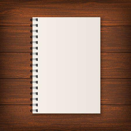 cuaderno de espiral realista en blanco en el fondo de madera.