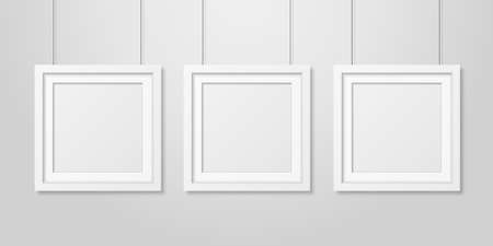 Three Vector Realistic Modern Interior White Blank Square Wooden Poster Picture Frame Set Hanging on the Ropes on White Wall Mock-up. Empty Poster Frames Design Template for Mockup, Presentation.