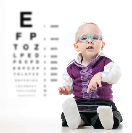 Kid in glasses sitting on the floor on a white background