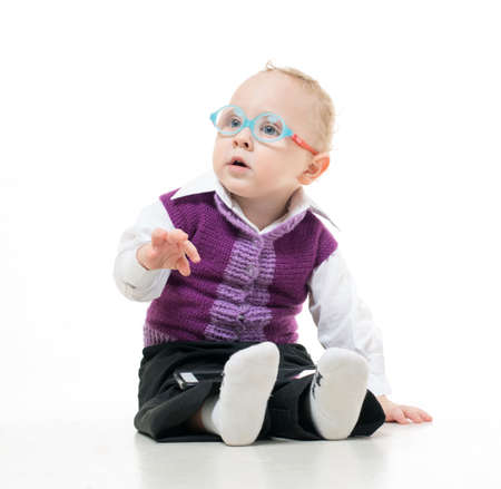 diopter: Kid in glasses sitting on the floor on a white background