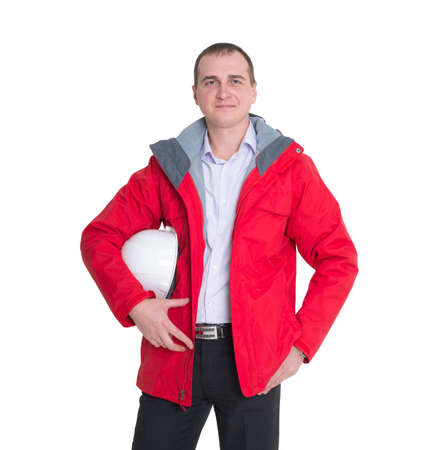 male construction worker in a red jacket and a protective construction helmet isolated on white background