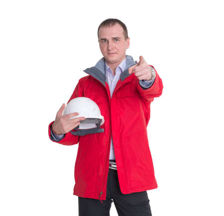 The man is construction worker in a red jacket and a protective construction helmet isolated on white background