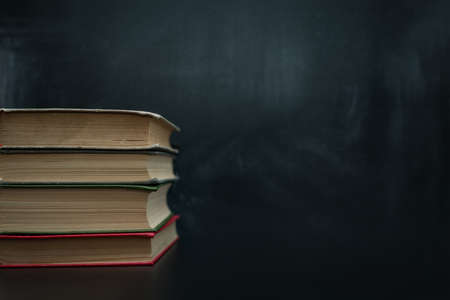 stack of books on a dark background