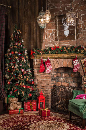 Interior Christmas room: fireplace, chair and tree