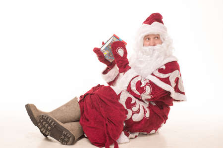 Portrait of Santa Claus in a red cap and a long white beard Stock Photo