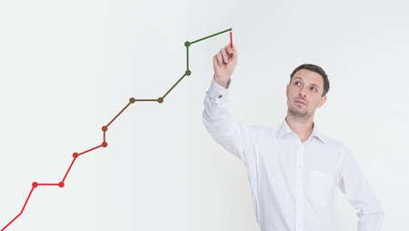 A man draws a graph of revenue growth