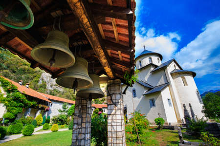 Moraca Monastery, a Serbian Orthodox monastery, church bells and courtyard in Kolasin, Montenegro. Stock Photo - 74334336