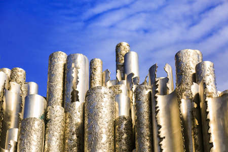 Hollow steel pipes welded together in wave-like pattern. Abstract concept art. Sibelius Monument in Helsinki, Finland.