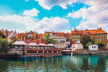 Scenic view of Prague Old Town. Historical buildings with colorful facades, rooftops and restaurant terraces on Vltava river in Prague 1 district, Czech Republic. Travel destination. Romantic city. Banco de Imagens