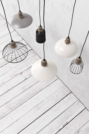 Many industrial pendant lamps in white blank interior above rust flooring
