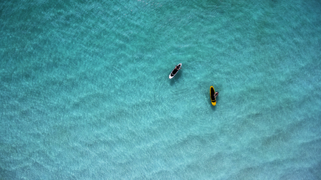 Aerial view of sup boards on the sea. Top view two paddleboard on a sunny day. View from above.