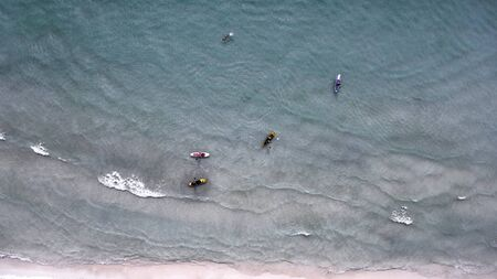 Aerial view of sup boards on the sea. Top view beachlife on a sunny day. View from above. Stock fotó