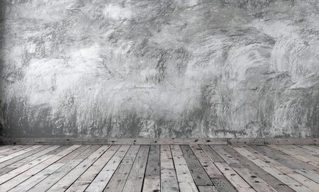 Blank de chambre de style minimaliste avec du ciment en plâtre gris au mur et du parquet en bois marron au sol. Murs en béton brut et planches avec noeuds sombres. Rendu 3D.