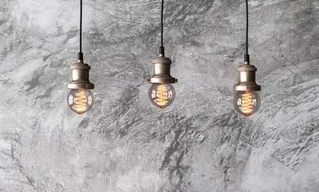 Loft pendant lamps on the background of rough cement plaster on the wall. Minimal loft interior. Edison light bulbs. 3d rendering. Stock fotó