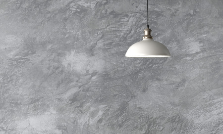 Industrial pendant lamps against rough wall with gray cement plaster. Edison light bulbs in loft style. Imagens