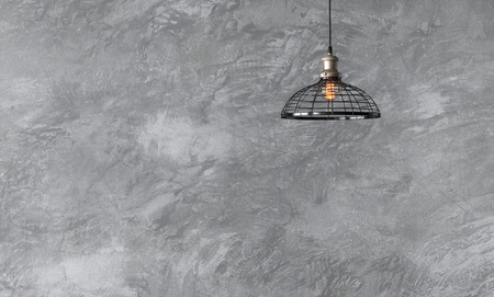 Industrial pendant lamps against rough wall with gray cement plaster. Edison light bulbs in loft style. Stock fotó