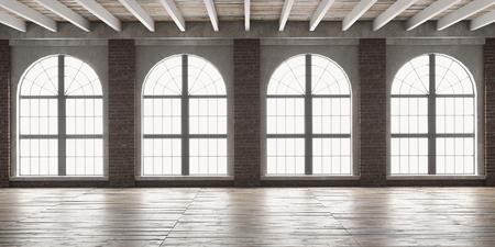 Großer leerer Raum im Loft-Stil mit großen Rundbogenfenstern. Innenspott oben mit Bretterboden und Backsteinmauer. 3D übertragen. Standard-Bild