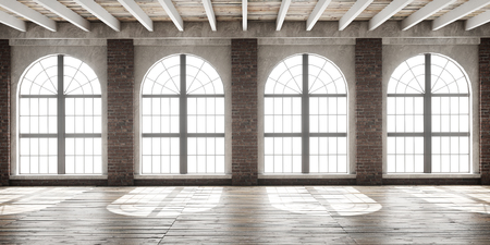 Large empty room in loft style with big arched windows illuminated by sunlight. Interior mock up with wooden floor and brick wall. 3D render.
