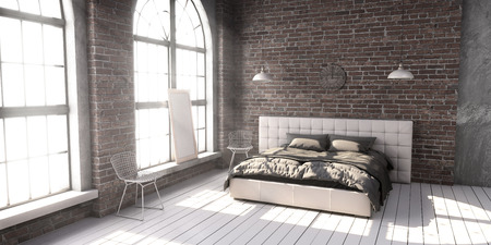 Quilted king size bed in the loft style bedroom in the rays of sunlight