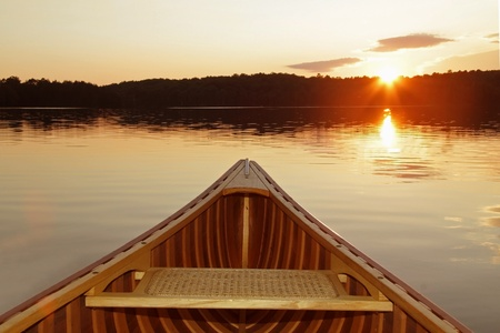 canoeing: Bow of Cedar Canoe on a Canadian Lake at Sunset