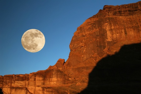 Moonrise Over Rock Formation - Canyon de Chelly, Arizona 写真素材