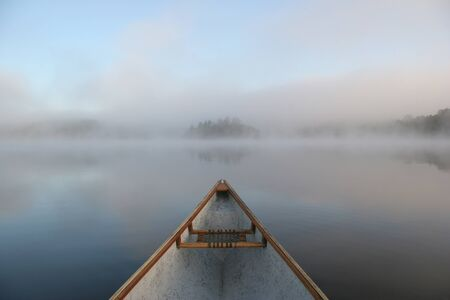 shorelines: Bow of a Canoe on a Misty Lake in Ontario, Canada