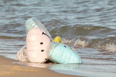 huron: Party Balloons with Smiley Faces Washed Up on a Beach - Lake Huron, Ontario