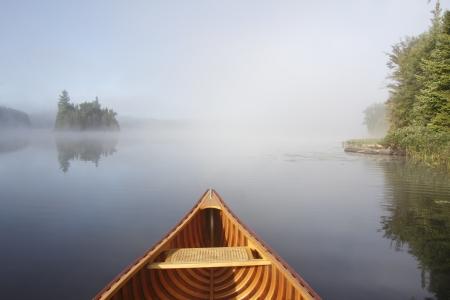 Bow of a Cedar Canoe on a Tranquil Lake - Ontario, Canada 스톡 콘텐츠