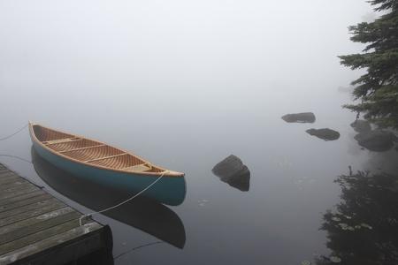 Canvas Cedar Canoe Tied to a Dock on a Misty Morning - Haliburton, Ontario
