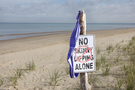 Women s Swimsuit Hanging From No Skinny Dipping Sign 写真素材