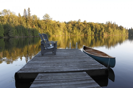 Canvas Cedar Canoe Tied to a Dock - Haliburton, Ontario photo